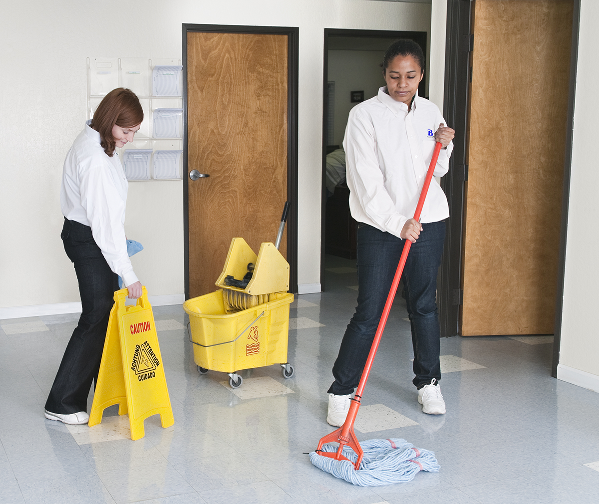 Beneficial Building Services Employees Mopping Floor